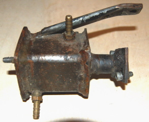 Water Cooled Intake Manifold.  This Particular manifold was constructed using simple pipe, square tubing and plate.  The water enters at the top of the unit and exist below.  The upper bracket connects to the cylinder head for structural support.